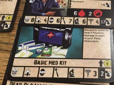 "Here is one of the members of my ""away team"" with all the equipment he starts his trip with. The symbols are for combat, survival, diplomacy, mechanical skill, scientific knowledge, medicine and the weight of the equipment. The balck arrow indicates there is something special about the equipment mentioned on its card, the number in the circle is its value, the red drop of blood is a characters strength and the number next to the red brain sysmbol is the characters mental heath. A mental helath of two is not good)."